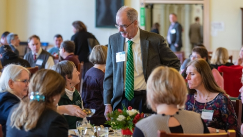 resident Philip J. Hanlon '77 chats with attendees at the annual employee service awards banquet last month. CREDIT: Photos by Lars Blackmore