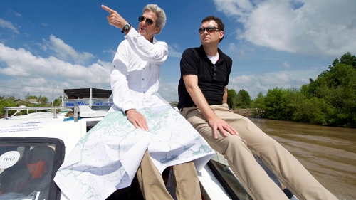 former Secretary of State John Kerry and Dartmouth history professor Edward Miller traveling the Mekong River Delta on a boat