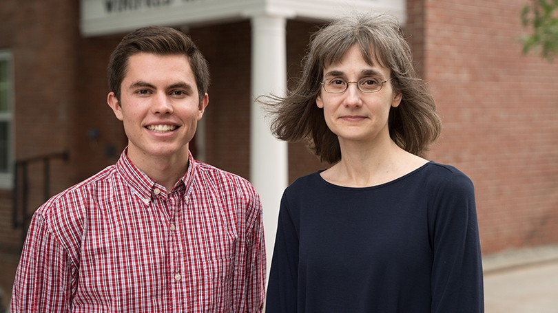 Kevin Griffee '19 and Professor of Education Donna Coch standing together outside
