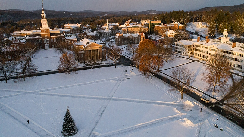 aerial photo of the Dartmouth Green covered in snow with a Christmas tree