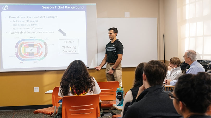 Garrett Schirmer '16 shows a QSS class how he uses data in his job with the Tampa Bay Lightning hockey team.